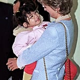 In February 1995, the Princess of Wales smiled at a young girl at the Umeda Akebone School in Tokyo, Japan.