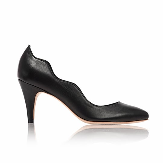 Talk about a functional shoe. I adore this Loeffler Randall Tilda Scallop Pump ($295), a shoe with just enough detail to make it interesting without being too crazy. The modest heel means you're comfortable at the office, but you still look edgy if you go out after work. —Maggie Pehanick, assistant editor
