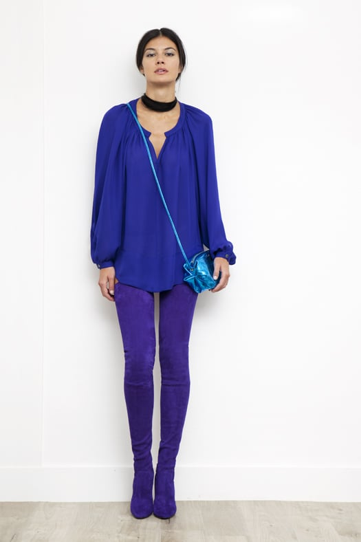 Peasant Blouse in Electric Blue Silk, Sweet Revenge Stretch Suede Legging Boot in Purple, Sunset Watersnake Small Cross Body in Turquoise. Photo courtesy of Tamara Mellon