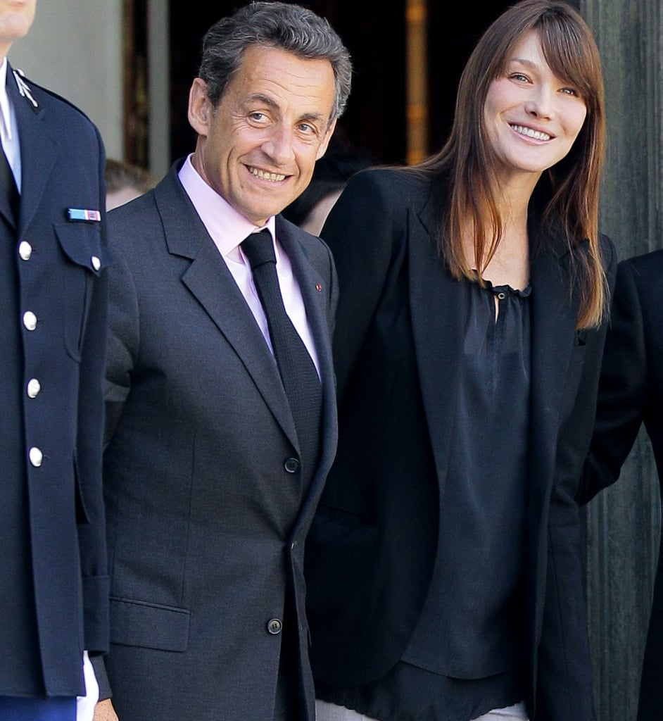 "France's first couple, President Nicolas Sarkozy and Carla Bruni, smile as they welcome South Korea's president and first lady to Paris today. Carla made her big-screen debut Wednesday at the Cannes premiere of Woody Allen's Midnight in Paris. But she decided not to make the trip down south for the festival, citing ""personal and professional reasons"" and fueling rumors that she's expecting. See more photos of the chic power couples now."