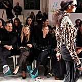 Issac Mizrahi sat front row with Mary-Kate and Ashley Olsen at the QVC fashion show.