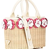 Cross two trends off your list with the Prada Embellished Wicker Basket ($1,730).