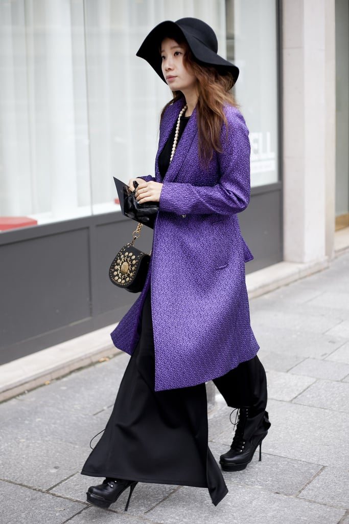 A gorgeous purple coat added a regal style element to this maxi dress.