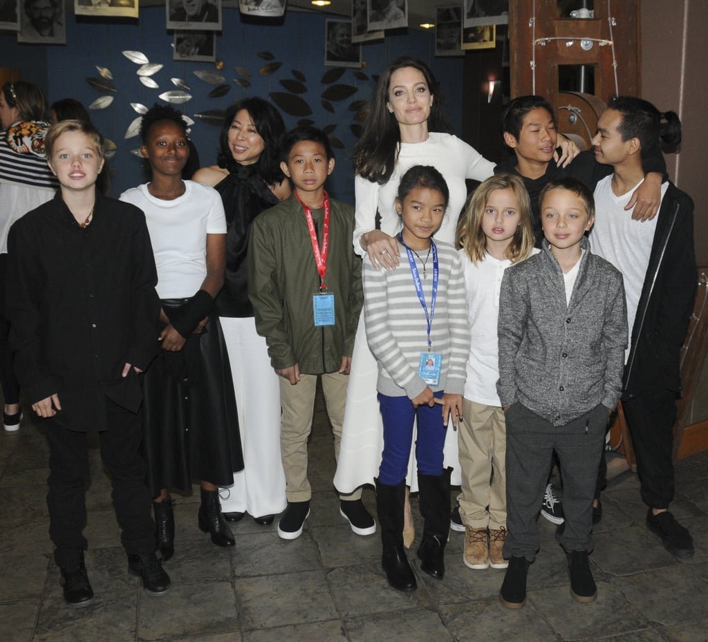 "Angelina Jolie turned Colorado's Telluride Film Festival into a family affair when she stepped out with all six of her kids on Saturday. The actress brought along Maddox, 16, Pax, 13, Zahara, 12, Shiloh, 11, and twins Vivienne and Knox, 9, to celebrate the premiere of her and Maddox's new movie, First They Killed My Father. Maddox served as an executive producer on the film, while Pax also assisted as an on-set photographer. Dressed in all white, Angelina was all smiles as she posed for photos with the cast and chatted with fellow actor Gary Oldman.         Related:                                                                                                           Everything That Has Happened Since Angelina Jolie Filed For Divorce From Brad Pitt               The film, which debuts on Netflix on Sept. 15, holds special meaning for Angelina and Maddox, as the actress adopted Maddox from Cambodia in 2002. Back in February, the brood attended the Cambodian premiere of the film and Maddox gave a speech to the audience, saying, ""We finally made it. It's a great honor to present this film to all of you, and to stand by my mother and my family."" We still can't get over how grown up all the kids are now."