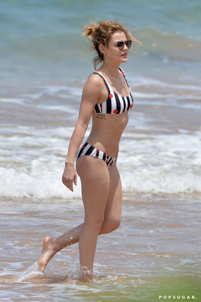 "Lucy Hale hit the beach with her former Life Sentence costar and boyfriend, Riley Smith, in Hawaii on Wednesday. The couple, who were first spotted together on a Valentine's Day date in February, looked happy and relaxed while swimming and sunbathing together. Lucy rocked a cute striped, cherry-print bikini that has us ready for Summer! Lucy and Riley's tropical getaway comes on the heels of the cancellation of their CW show after one season. On Tuesday, Lucy tweeted out a message to fans, saying, ""Just got the sad news that Life Sentence will not be coming back for a second season,"" adding, ""I'm so proud of what we accomplished [and] for the experience I had."" On the show, Lucy played a young woman named Stella who originally thought she had no life to live as she discovers that she no longer has cancer. Riley played a doctor who hits it off with the married Stella. Keep reading to see Lucy and Riley's real-life romance on the beach!"