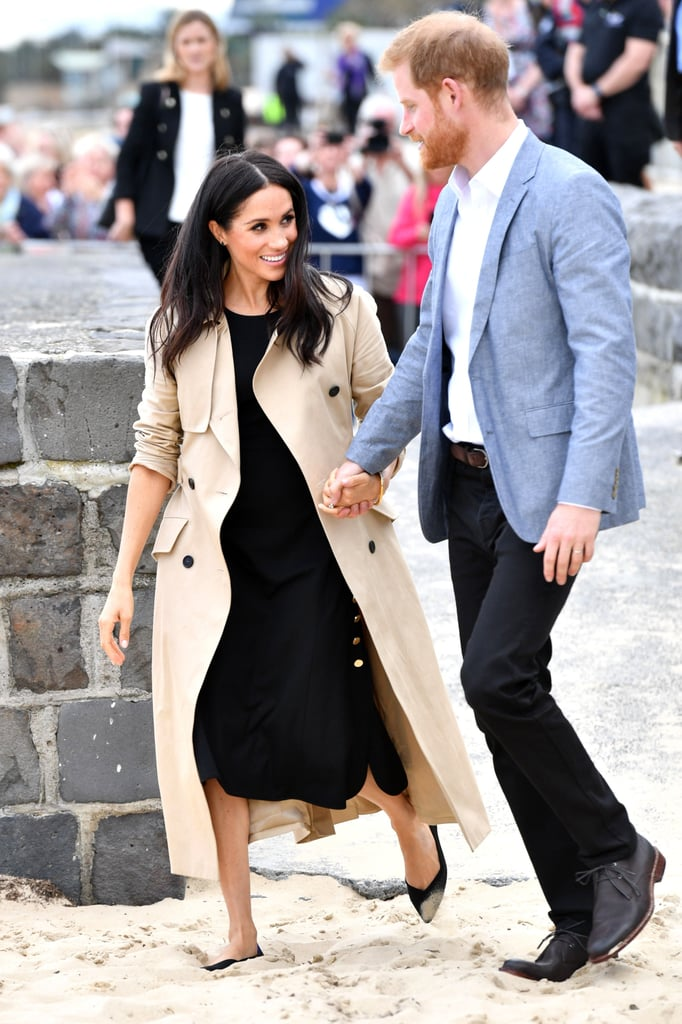 Prince Harry and Meghan Markle's royal tour of Australia is starting to look more like a Nicholas Sparks movie, wouldn't you agree? Between Meghan and Harry giving each other heart-eyes and their sweet gestures for one another, it's clear that these two are royally in love. To top it all off, during the couple's stop in Melbourne, Australia, on Thursday, Harry and Meghan shared another tender moment that you probably missed.  As the pair were being shown an Aboriginal art mural, Harry, who was already holding one of his wife's hands, reached behind his back with his other hand and lovingly stroked hers with his thumb. Aw! We're only four days into their 16-day tour, and something tells us there will be even more cute moments to come.      Related:                                                                                                           Prince Harry's Reaction to a Man Giving Meghan Markle a Huge Bouquet of Flowers Is Priceless