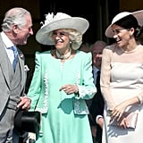 Charles and Meghan shared a laugh with Camilla at his 70th birthday celebrations in May 2018.