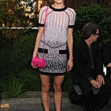 Jessica Stam opted for a party dress, but pared it down with a smart pair of oxfords. We love the pop of bubblegum pink on her Coach bag to lend a little playfulness.