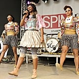 Unlike her first look, Santigold went kitschy for her onstage performance. Striped leggings, a circle skirt, and floral tiara completed her princess-quirk ensemble.