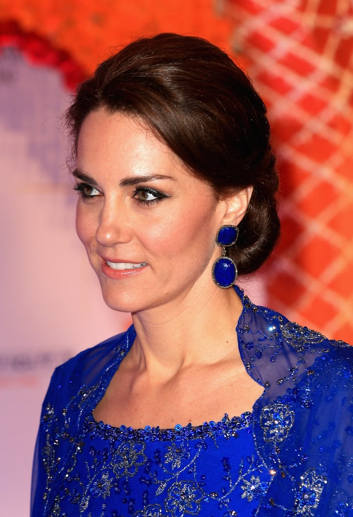 Kate Middleton and her husband, Prince William, are nearing the end of a week-long tour of India and Bhutan. Each day has so far called for a number of outfit changes — and for the duchess, that also means a new hair and makeup look. Fortunately, Kate's traveling with her beloved hairdresser, Amanda Cook Tucker. When it comes to makeup, Kate's often known to do her own touch-ups.  The tour has called for a range of looks, from black-tie ready to more casual, fresh-faced styles for meet-and-greets and afternoons out in the sun. As we follow along with all the highlights from Will and Kate's tour, we're also paying close attention to the high points of her hair and makeup on the road.
