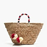 """""""Funky and finished with a patriotic splash of color, this Kayu St. Tropez Tote ($115) is the ultimate beach bag."""" — HWM"""
