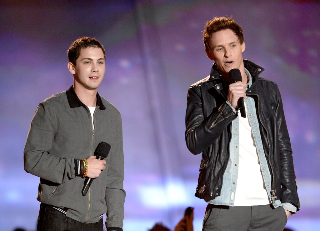 Eddie Redmayne and Logan Lerman presented Emma Watson with her trailblazer honour at the MTV Movie Awards.