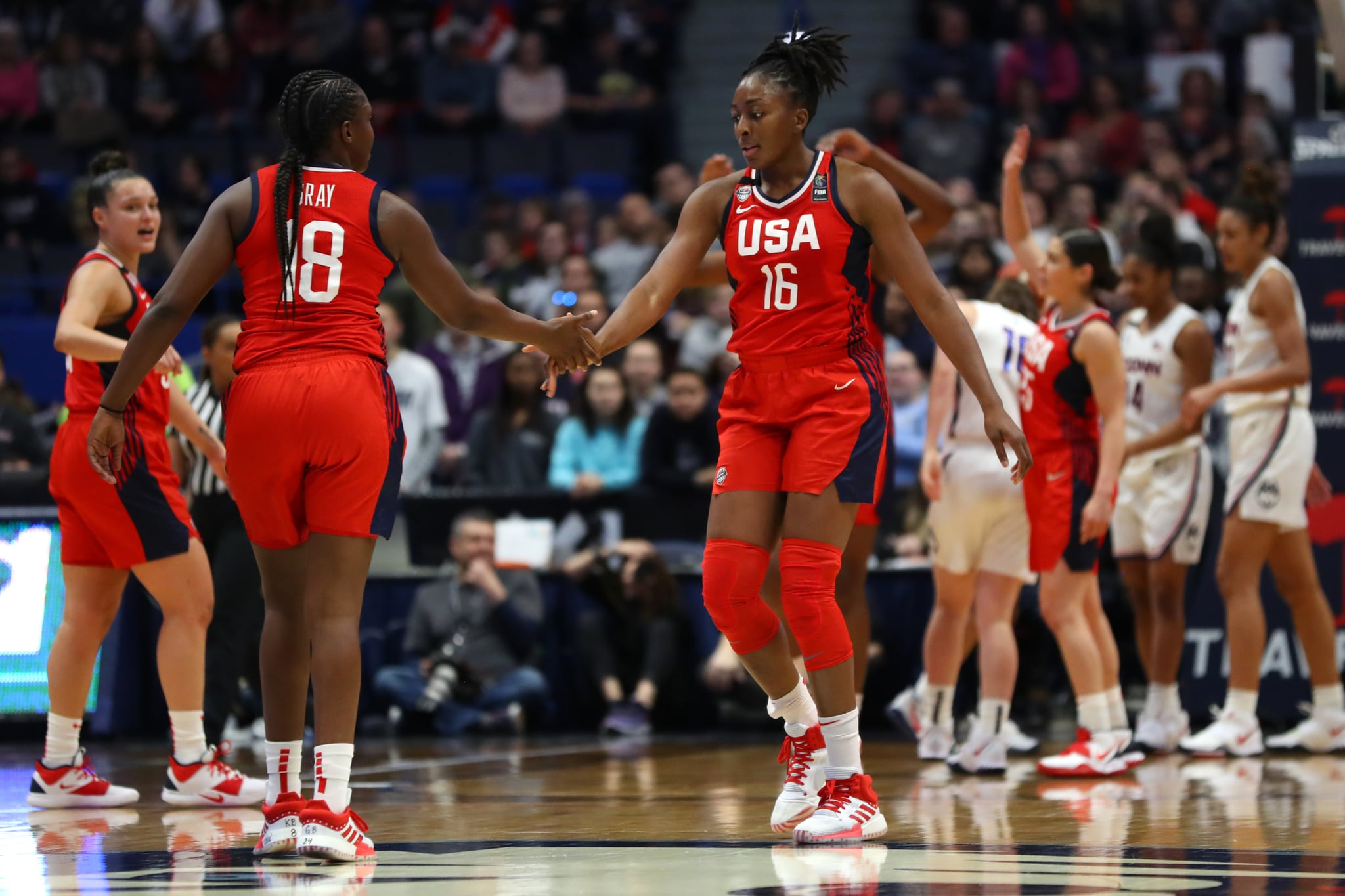 HARTFORD, CONNECTICUT - JANUARY 27: Nneka Ogwumike #16 and Chelsea Gray #18 of the United States celebrate during USA Women's National Team Winter Tour 2020 game between the United States and the UConn Huskies at The XL Centre on January 27, 2020 in Hartford, Connecticut.  (Photo by Maddie Meyer/Getty Images)
