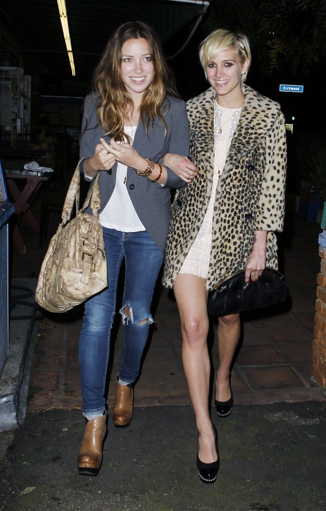 Ashlee Simpson linked arms with a friend.