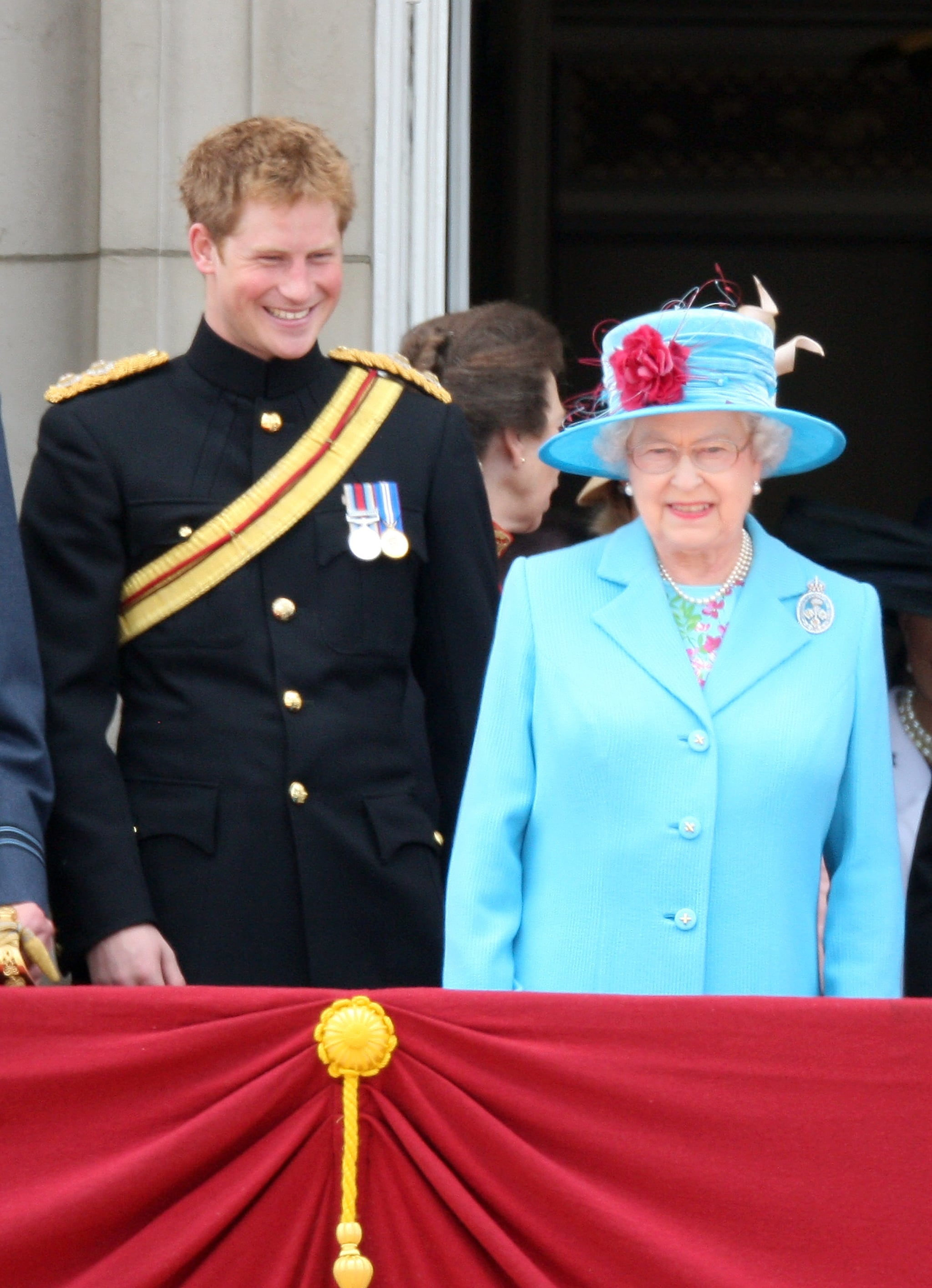 LONDON, ENGLAND - JUNE 13:  HRH Prince Harry, Laughs next to HM Queen Elizabeth II as they look out from the balcony of Buckingham Palace after the Trooping the Colour ceremony on June 13, 2009 in London, England. The ceremony of Trooping the Colour is believed to have first been performed during the reign of King Charles II. In 1748, it was decided that the parade would be used to mark the official birthday of the Sovereign. More than 600 guardsmen and cavalry make up the parade, a celebration of the Sovereign's official birthday, although the Queen's actual birthday is on 21 April.  (Photo by Chris Jackson/Getty Images)