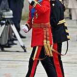 Prince William in Irish Guard uniform, Prince Harry in Blues and Royals with gold brocade