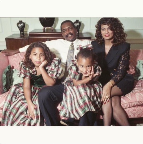 """On Christmas Day, Solange Knowles shared crazy-cute throwback photos of her family, including some sweet snaps with her sister, Beyoncé. In one picture, the cute pair is posing with their parents, and in another, they're having one seriously adorable modeling moment. The sisters are sporting matching dresses in both photos, and in one caption, Solange wrote, """"'Can't be be bothered' since 90. . . . Merry Christmas!"""" Solange's photos were posted soon after Beyoncé shared pictures of her Iceland trip with Jay Z. Earlier in the week, the couple was spotted out in NYC, where Beyoncé rocked a hot-pink suit. Take a look at Solange's adorable snaps, and then see how your favourite stars celebrated Christmas!"""