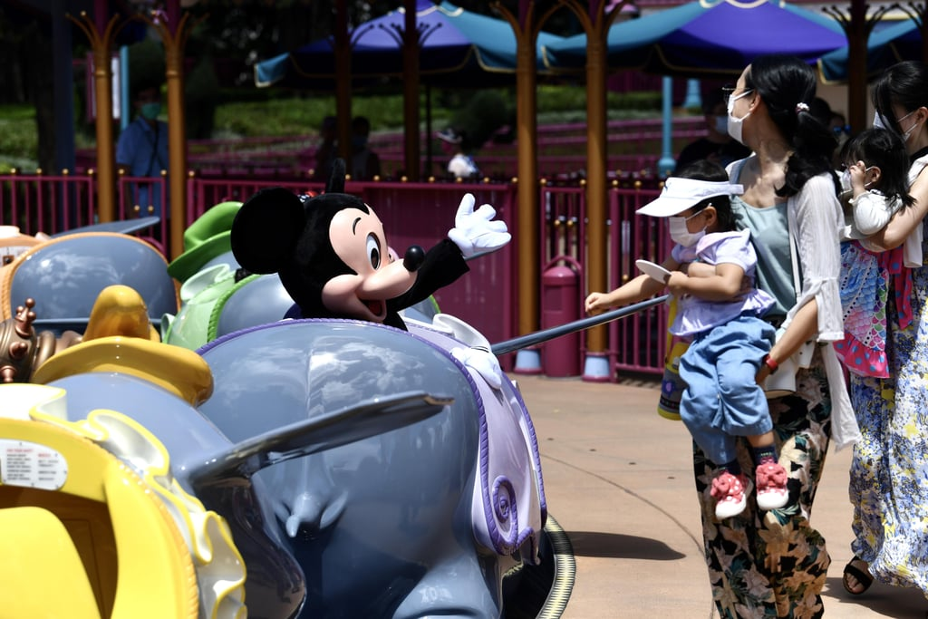 "Hong Kong Disneyland began its phased reopening plan on June 18, opening its doors to guests for the first time since closing temporarily due to the coronavirus pandemic on Jan. 26. It's the second Disney resort to open up following Shanghai Disneyland, which reopened on May 11. As of its initial reopening, a majority of Hong Kong Disneyland's attractions, restaurants, and shops are open, but the park is taking guests at a limited capacity and has rolled out enhanced health and safety procedures such as mask-wearing and social distancing. ""Creating magic today means even more to us than ever before. This was especially apparent as thousands of talented and dedicated Hong Kong cast members came together to take great care in preparing the park for the return of our guests,"" read a June 18 statement on the Disney Parks Blog. ""As we reopened our park today, we reflected on the strength and resilience of our community, the perseverance of our cast members, the support from our guests and the unwavering commitment of our medical responders. To each of these groups – we thank you for your significant contributions that helped lead us to this special moment . . . Today serves as an important step forward for Hong Kong Disneyland. We are excited not only about upcoming milestones for our park, but also for the rest of our Disney parks around the world."" In the US, Walt Disney World has already opened Disney Springs, and will open Magic Kingdom and Animal Kingdom on July 11, followed by Hollywood Studios and Epcot on July 15. Meanwhile, Disneyland will reopen Downtown Disney on July 9 and its parks once it has approval from California government officials. Keep scrolling to see photos of what Hong Kong Disneyland's reopening amid the pandemic looks like, as well as a video put together by the park.      Related:                                                                                                           Disney World Has Canceled Its 2020 Mickey's Not-So-Scary Halloween Party Celebrations"