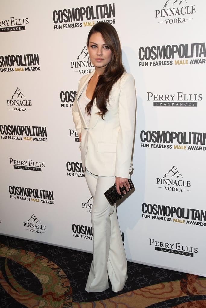 Mila Kunis looked impeccably chic in all white — making us all wish we had occasion to sport the suit.