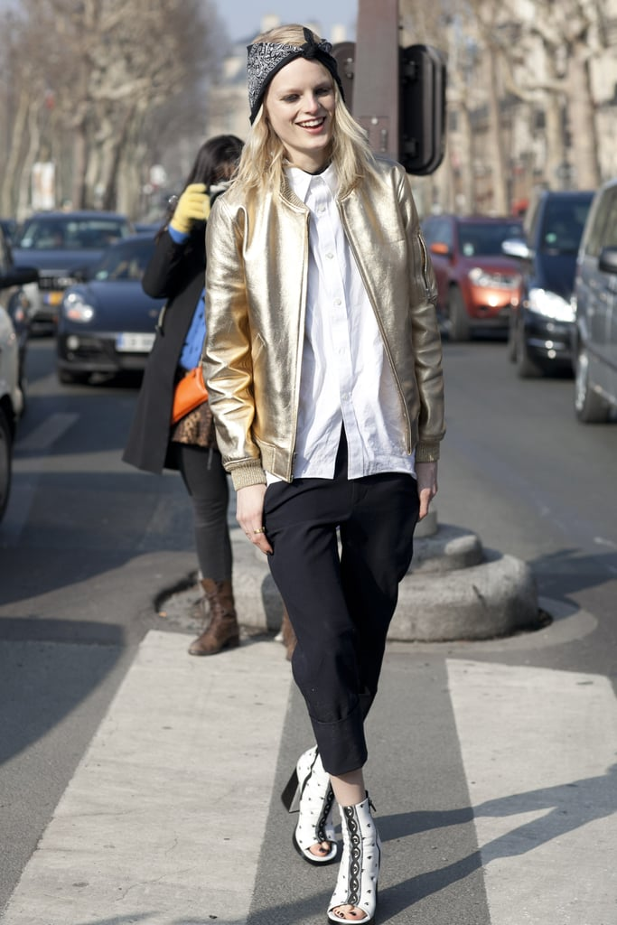 Hanne Gaby Odiele dressed up a classic white button-down and trousers with sandal boots and a metallic bomber.