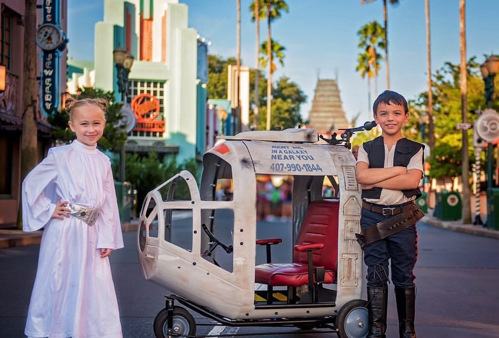 As if the recent opening of Star Wars: Galaxy's Edge at Walt Disney World wasn't exciting enough, one stroller rental company is making the land and its theme even more enticing with its new spaceship strollers. Fantasy Strollers, which currently rents out Cinderella's Carriage strollers to parents visiting Disney World, just added a spaceship stroller to its lineup, and it's perfect for your mini Rebels. The strollers are available for use in Magic Kingdom and Hollywood Studios, where they can be picked up and dropped off at designated locations in the park and at the nearby resorts. As far as rental fees go, the spaceship stroller starts at $100 for the day (from 9 a.m., 10 a.m., or 11 a.m. to 5 p.m.), with a $20 per hour charge for each hour after 5 p.m. Or, you could purchase the Fireworks Extension Package for the day, which gives you the rental until 10 p.m. for an extra $50 (compared to $100 when calculated per hour).      Related:                                                                                                           Disney World Is Releasing SO Many Star Wars Treats, Including Lightsaber Churros!               The strollers' features include ceiling fans, interior and exterior lights, phone chargers, cup holders, ample storage space, and of course, authentic touches such as Millennium Falcon-style doors and two pilot steering wheels. And after a long day enjoying Disney, there's the best feature of these spaceship strollers that parents will enjoy the most — it transforms into a bed so that your sleepy kiddos can catch a few Zs wherever you are in the park. Additionally, each stroller measures 20 inches wide by 50 inches long, which is within Disney's stroller size limit. See photos of the Millennium Falcon-esque stroller ahead, and book one for your upcoming vacation (Fantasy Strollers recommends booking four to eight months in advance, as there are limited quantities of this new design)!      Related:                                     