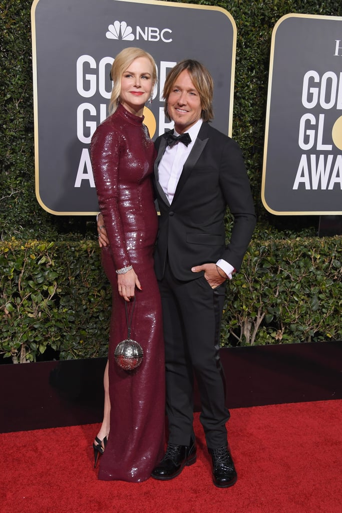 "It's hard not to swoon over Nicole Kidman and Keith Urban whenever the two are spotted together. The two have undeniable chemistry and one of the longest lasting relationships in Hollywood (12 years to be exact). Although they first got together back in 2005, Nicole can still recall the moment she knew she wanted to marry Keith. In an new interview with People magazine, the Destroyer actress shared the sweet gesture he made on her 38th birthday — just a few months after meeting her. ""It was my birthday, and he stood outside with gardenias at 5 a.m. on my stoop in New York,"" Nicole told People. ""That is when I went, 'This is the man I hope I get to marry.'"" She also remembered one of their most special dates, on which they rode a motorbike to Woodstock, NY, for a getaway, adding, ""My kind of guy!"" It all seemed to happen rather quickly, but Nicole knew what she felt. ""It was pretty intense,"" she continued. ""I believed by that point he was the love of my life. Maybe that's because I am deeply romantic, or I'm an actress, or I have strong faith as well, but I just believed, 'Oh, okay, here he is.'"" But Nicole wasn't the only one who fell quickly. Keith has also said that it was love at first sight when he met the Big Little Lies star. A year after they started dating, the couple tied the knot in Manly, Australia, and now live in Nashville with their two daughters, Sunday, 10, and Faith, 8. From supporting each other at awards shows to making out on the beach, the spark is still very much alive for these lovebirds. See a few of their cutest photos together ahead!"