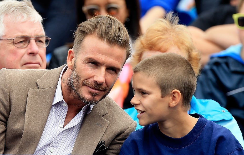 """Fresh off his """"inspiring"""" visit to Africa with UNICEF, David Beckham attended the Aegon Championships at the Queen's Club in London on Tuesday with his adorable son Romeo in tow. The pair was all smiles as they attentively took in the tennis match between Stan Warinka and Fernando Verdasco in the stands, and at one point, Romeo was seen adorably whispering something in David's ear. Just two days prior, the father-son duo were spotted at the venue hanging out with tennis pros Nick Kyrgios and Andy Murray. Romeo even got to practice his swing and hit a few balls with Andy before the tournament. Noticeably missing from the fun was the rest of the Beckham clan, though Victoria has been hard at work promoting her sunglasses line while Brooklyn has been improving his photography skills. Read on for more cute photos, then check out the family's sweetest moments through the years."""