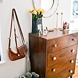 Can't fit a dresser? Try putting it in the entryway, and let it double as an entry table. Maximizing your furniture's functions is a great way to save space in a small apartment.