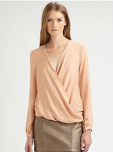 The soft neutral shade on this Haute Hippie draped long-sleeved blouse ($275) would look gorgeous against a pair of crisp white jeans.