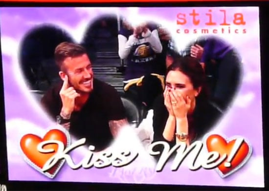 David Beckham and Victoria Beckham on the Kiss Cam.