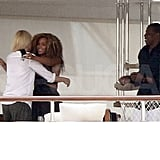 Jay-Z watches and Beyoncé Knowles and Gwyneth Paltrow hug.