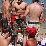 Zac Efron shirtless on the beach.