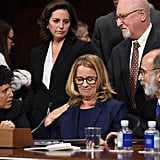 Ford is surrounded by her attorneys before testifying.