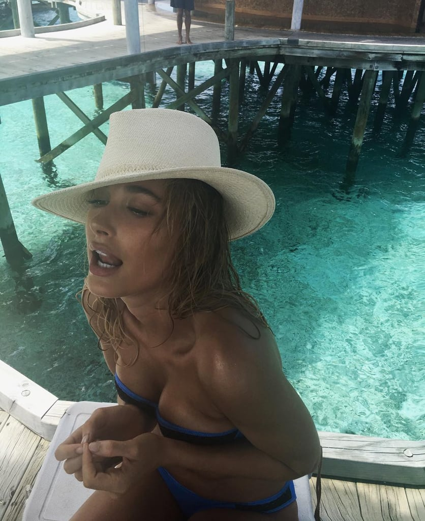 Accessorising with a hat, Hailey gave us some vacation and Summer inspiration in a strapless black and blue suit.
