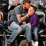 David Beckham planted a kiss on son Cruz Beckham while at the Lakers game together in LA.