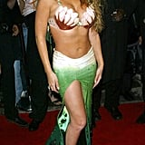 Mariah Carey showed skin in a mermaid costume at her 2003 NYC bash.