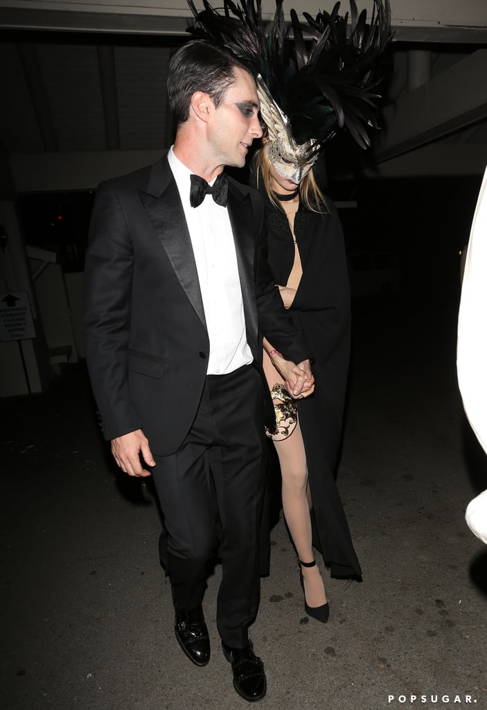 Adam Levine and Behati Prinsloo wore classy masquerade ensembles.