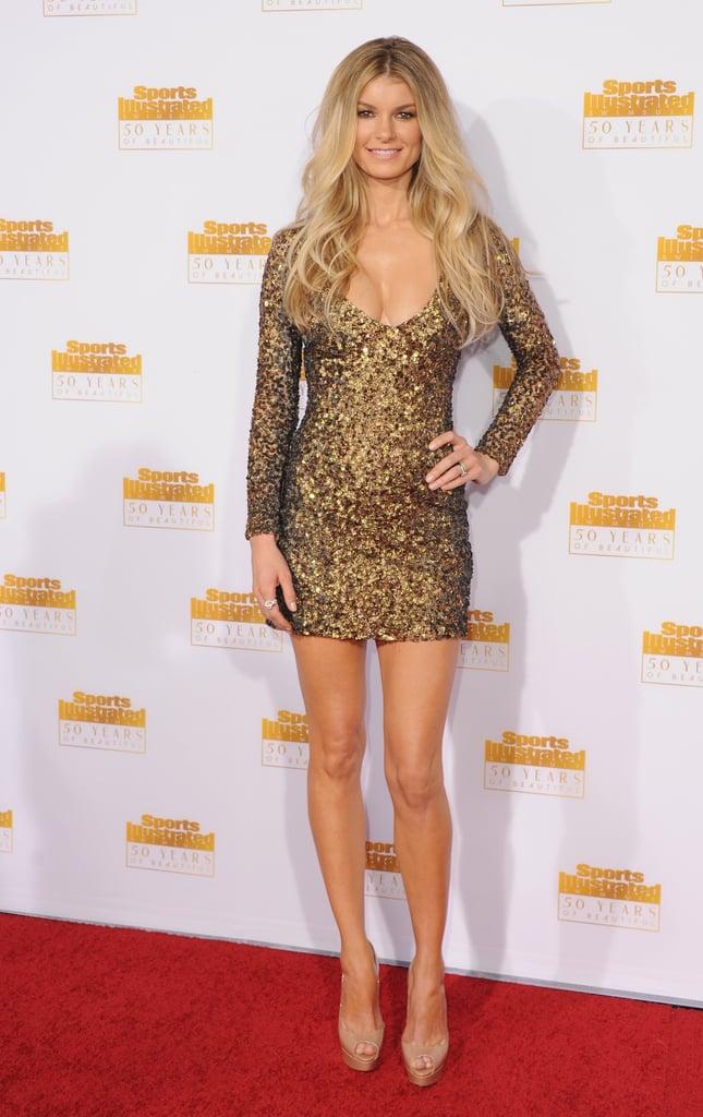 marisa miller showed skin in a low cut dress sports