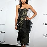 Naomie Harris brought dark glamour to The Weinstein Company party in Cannes in a sheer strapless number and bow sandals.