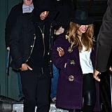 Jay Z held Beyoncé's arm as they left Taylor's building