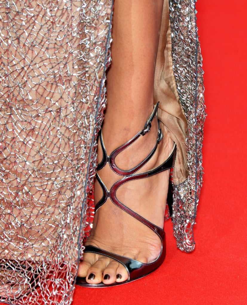 Freida Pinto wore strapped metallic sandals to match a glitzy dress.