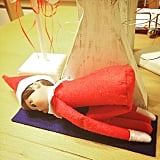 For this stressful time of year, Child's Pose makes Elfie feel calmer.
