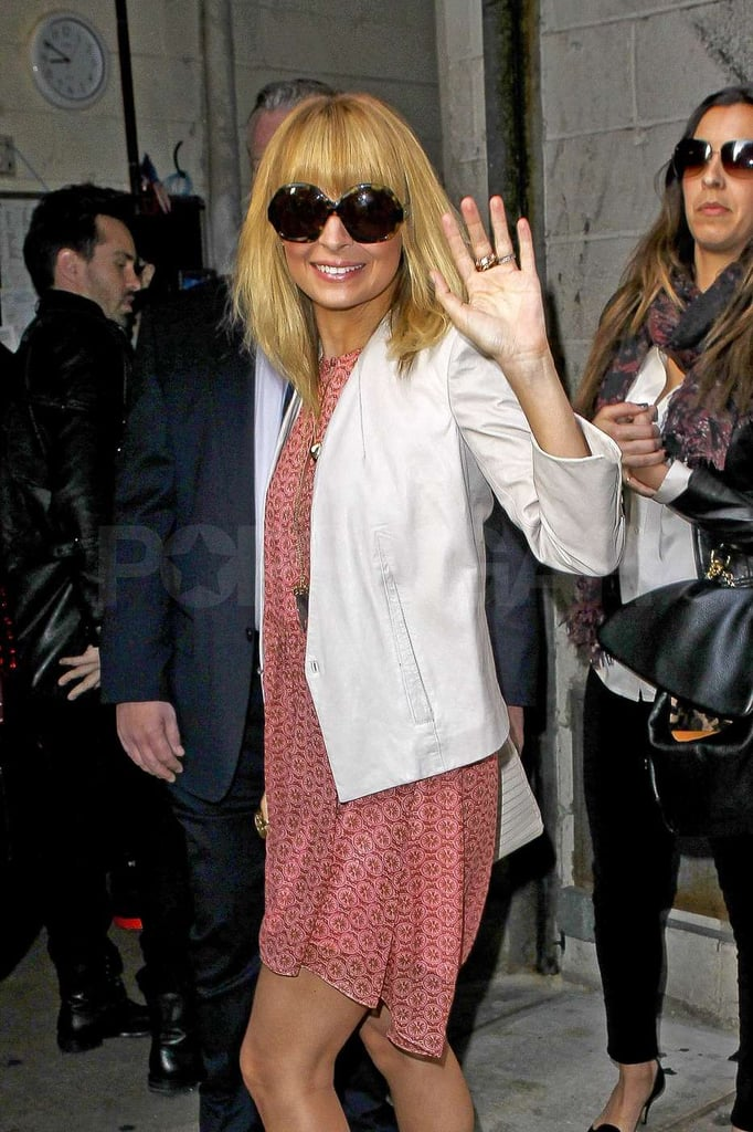 Nicole Richie topped her dress with a white blazer.