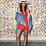 Chanel Iman wearing a red dress with a denim jacket at #REVOLVEfestival.