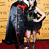 Kellan Lutz showed off his muscles in a Batman suit and his Twilight costar Ashley Greene was sexy in feathers as they cohosted a Vegas Halloween celebration in 2009.