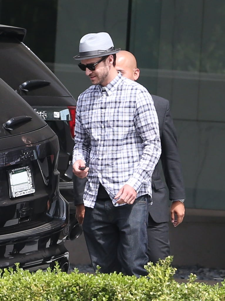 Justin Timberlake kept it casual in a plaid button-up and fedora.