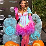 Christina Milian got colorful in costume to launch her special Halloween cocktail recipe at Beacher's Madhouse in LA on Friday.