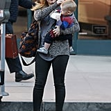 Hilary Duff held onto Luca as he drank from a bottle.