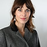 Alexa Chung smiled at the Christopher Kane show during LFW.