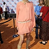 Mandy Moore's nude boots and woven belt provided a soft contrast to the peach-hued minidress she wore to the 2002 Kids' Choice Awards.